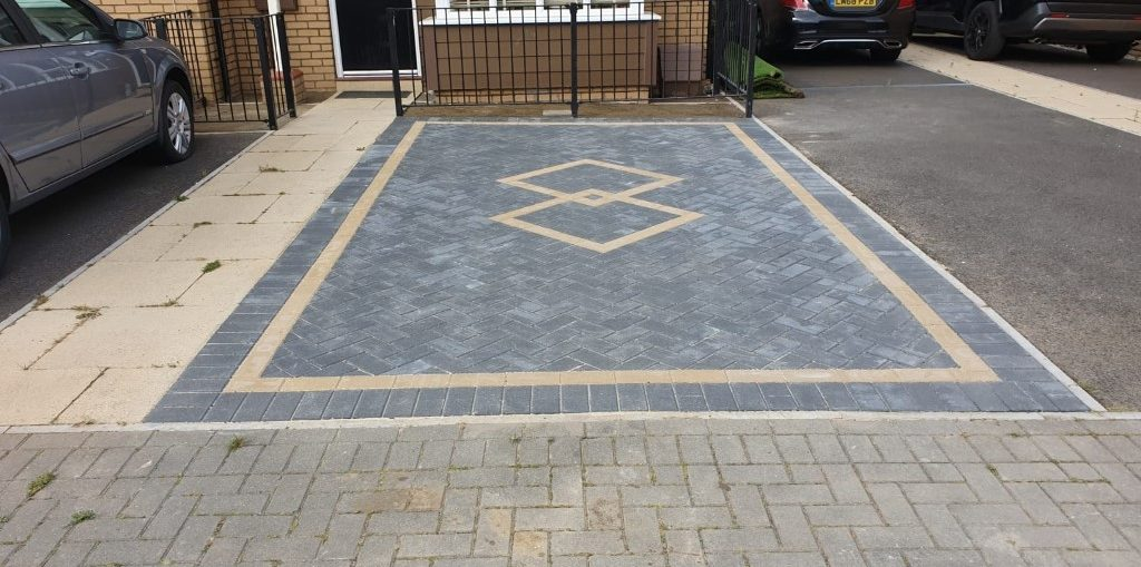 Charcoal Block Paving Driveway with an Insert in Milton Keynes